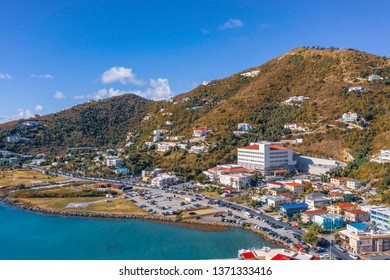 Scenic aerial view of capital of British Virgin Islands Tortola. Beautiful sunny summer landscape of little tropical islands in Caribbean sea. Look of port of small town on green hills.