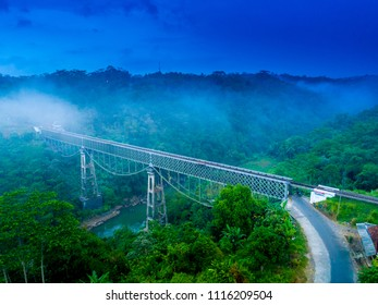 Scenic Aerial View of Cirahong Bridge, A Double Deck Structure of Metal Railway Bridge and Car Bridge Underneath Made by Dutch Colonial, Manonjaya Tasikmalaya, West Java Indonesia, Asia