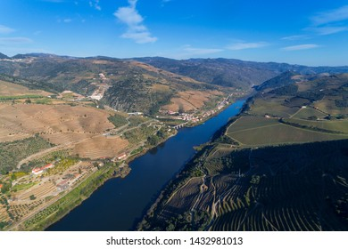 Scenic aerial view of the Douro Valley and river with terraced vineyards near the village of Tua, Portugal