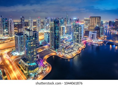 Scenic aerial view of Dubai Marina by night. United Arab Emirates. Colourful travel background.