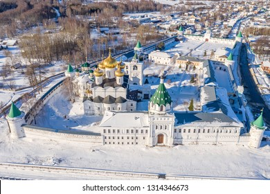Scenic aerial view of famous Ipatievsky (Hypatian) Monastery in ancient touristic town Kostroma in Russia. Beautiful winter look of old russian orthodox temple with gold-plated domes covered by snow