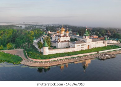 Scenic aerial view of famous Ipatievsky (Hypatian) Monastery in ancient touristic town Kostroma in Russia. Beautiful look of old russian orthodox monastery with gold-plated domes in morning light