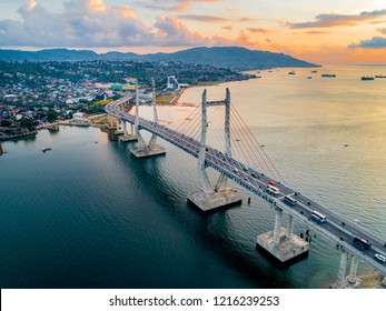 Scenic Aerial View of Iconic Merah Putih Cable Stayed Bridge accross Ambon Bay, Maluku, Indonesia