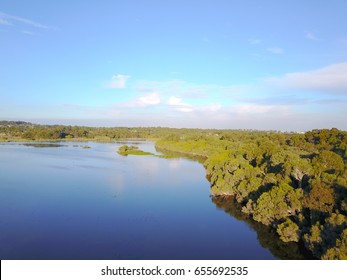Scenic Aerial view of Lake Joondalup wetland panorama in Perth, Western Australia, with cloud reflections in tranquil clear water, copy space.