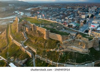 Scenic aerial view of medieval Gori Fortress on hilltop above Georgian city of Gori during spring sunset, Shida Kartli region - Shutterstock ID 1969493914