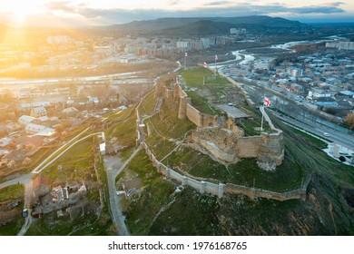 Scenic aerial view of medieval Gori Fortress on hilltop above Georgian city of Gori during spring sunset, Shida Kartli region - Shutterstock ID 1976168765
