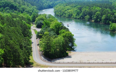 Scenic Aerial View Overlooking A Curvy Road And Beautiful Blue River