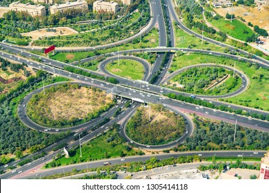 Scenic aerial view of two-level road junction in Tehran, Iran. Day traffic of expressways. Tehran is a popular tourist destination of the Middle East.