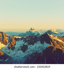 scenic alpine landscape with and mountain ranges. natural mountain background. vintage stylization