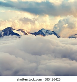 scenic alpine landscape with mountain ranges. natural mountain background. vintage stylization