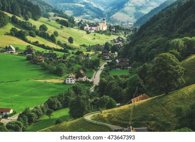 Scenic autumn countryside landscape. Mountain valley with forests, fields and old houses in Germany, Black Forest