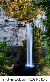A scenic, autumn glance at the powerful and vertical Taughannock Falls near Ithaca, New York.