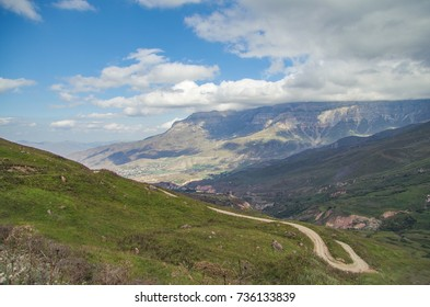 Scenic autumn landscape in the Caucasus Mountains. Empty mountain winding road. Sharp bend. Nature and travel. Russia, North Caucasus, Dagestan