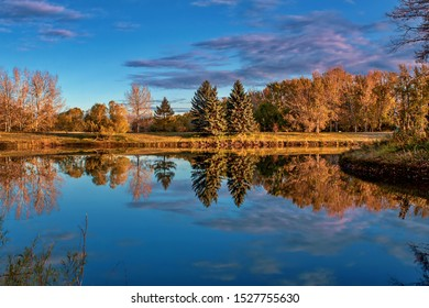 Scenic autumn morning lake reflections