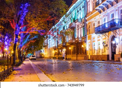 Scenic autumn night view of the Old Town illuminated architecture with a lot of color street lights at Primorsky Boulevard, Odessa, Ukraine