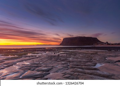 Scenic autumn  sunrise at The Nut. The remains of an ancient volcanic plug.Image taken from Godfreys Beach,rock shelf in foregroud.Stanley,North West Tasmania,Australia.