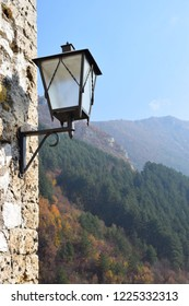 Scenic autumn view on stones and colorful hills and forest from ancient fortress in Travnik,Bosnia and Herzegovina. minimalism photograph with old lighting in center of attention