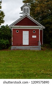 A scenic, Autumn view of a traditional, red one-room school in the Jansen Kill valley of eastern New York.