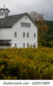 A scenic, Autumn view of a white-sided barn in the Jansen Kill valley of eastern New York.