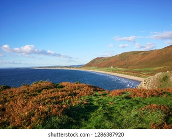 Scenic beach on the Gower Peninsular during the autumn with blue skies and sunshine.