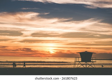 Scenic Beach Sunset in Oceanside, California, USA. Beach with Wooden Lifeguard Tower.