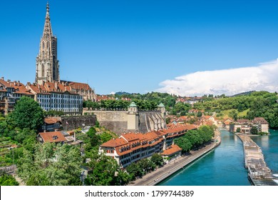 Scenic Bern old town cityscape with old buildings Bern Minster cathedral tower and Aare river view in Bern Switzerland