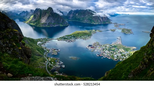 Scenic bird's eye view of the picturesque village of Reine and surrounding fjord of Reinefjorden on the Lofoten Islands in Norway from the top of Reinebringen mountain