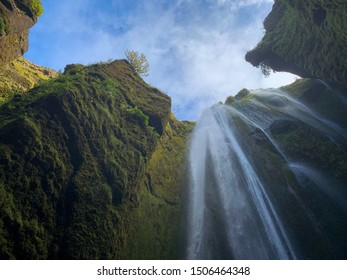Scenic bottom up view of Gljúfrafoss waterfall from a cave in Iceland, amazing view of secret waterfall landscape