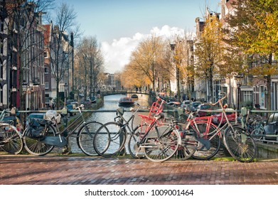Scenic of  bridge with bicycles parked over the canals of Amsterdam, Netherlands.