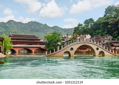Scenic bridges over the Tuojiang River (Tuo Jiang River) in Phoenix Ancient Town (Fenghuang County), China. Fenghuang is a popular tourist destination of Asia.
