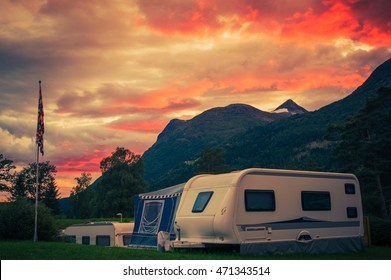 Scenic Camping Sunset. Sunset Sky Over Campground with Travel Trailers. Campsite Caravan Camping.