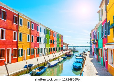 Scenic canal with colorful buildings in Burano island, Venice, Italy