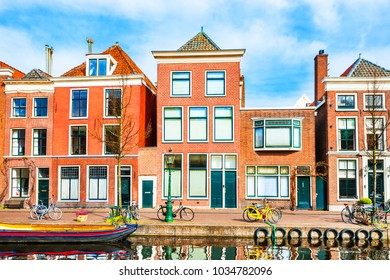 Scenic canal with traditional dutch architecture in Leiden, Netherlands