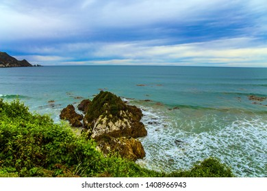 Scenic Cannibal Bay. Pacific coast of the South Island. New Zealand. Powerful ocean surf. The concept of ecological, active and phototourism