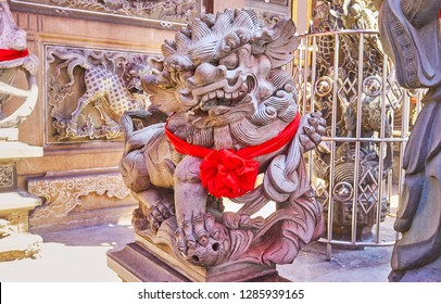 The scenic carved  stone statue of Chinese Guardian Lion, also named Foo Dog or Chinthe in front of the Kheng Hock Keong Temple, Yangon, Myanmar.