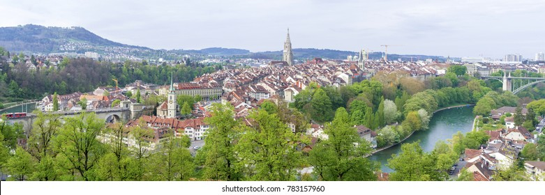 Scenic of The city of Bern, the capital of Switzerland. Bern is built on very uneven ground. The Aare river flows in a wide loop around the Old City of Bern, a UNESCO World Heritage Site.