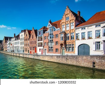 Scenic city view of Bruges with waterway along beautiful medieval houses.