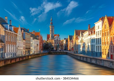 Scenic cityscape with canal Spiegelrei and Jan Van Eyck Square in the morning in Bruges, Belgium