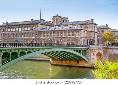 Scenic cityscape of Paris with the Seine, d'Arcole bridge and Notre-Dame towers in fall, Paris, France