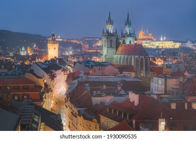 Scenic cityscape view from Powder Tower of the Church of our Lady Before Tyn and the Gothic old town Prague in Czech Republic illuminated at night.