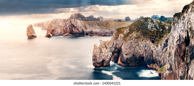 Scenic cliff landscape and sea in storm weather.Cliffs of hell in Spain,Asturias.Beautiful and dreamlike rocks in the ocean.
