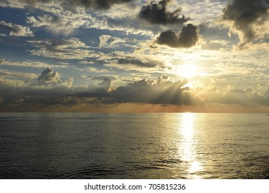 Scenic clouds over the sea at sunset