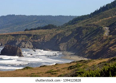 The scenic coast of northern California, along Highway 101 showing the road that hugs the cliffs along the ocean on a summer day