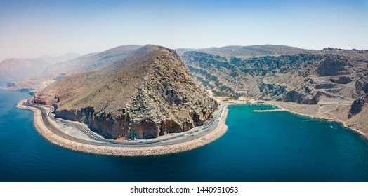 Scenic coastal highway and fjords of Musandam in Oman aerial view