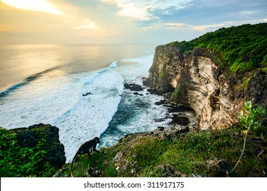 Scenic coastal landscape of high cliff at sunset near Uluwatu Temple, Bali island, Indonesia