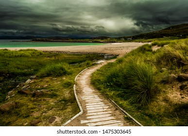 Scenic Coastal Landscape With River And Wooden Footpath In Scotland