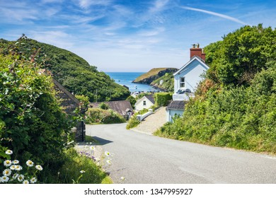 Scenic coastal village view from the side of the rural road at bright summer day in Abercastle, Pembrokeshire, UK