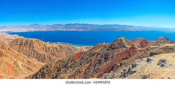 The scenic colorful landscape of Eilat mountains with Aqaba Gulf in the distance, Israel.