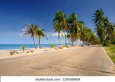 Scenic concrete road along paradise Ban Krut beach at Bang Saphan district of Prachuap Khiri Khan province of Thailand.