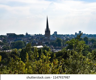 Scenic, daytime, cityscape view of Norwich Cathedral from the top of mousehold heath in Norwich.